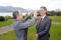 Prof Seán Tierney presents Dr Ronan Boland with the chain of office