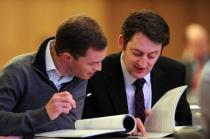 Dr Trevor Duffy and Dr Matthew Sadlier considering Motions for debate, AGM 2012